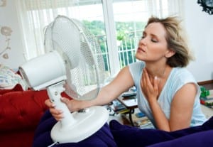 Fan Cooling a Woman