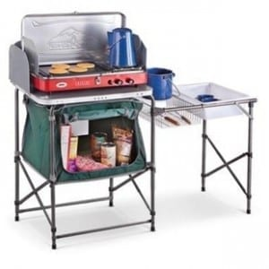 A camping kitchen like this $80 model from Bargain Outfitters is great for cooking on the road.