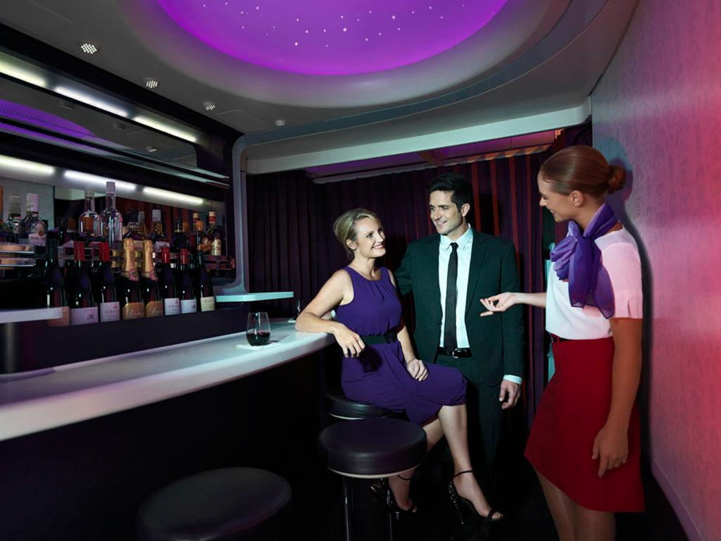 A couple enjoys a refreshing beverage mid-flight on Virgin Australia (photo via flyvirgin.com)