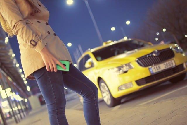 Taxi picking up a passenger