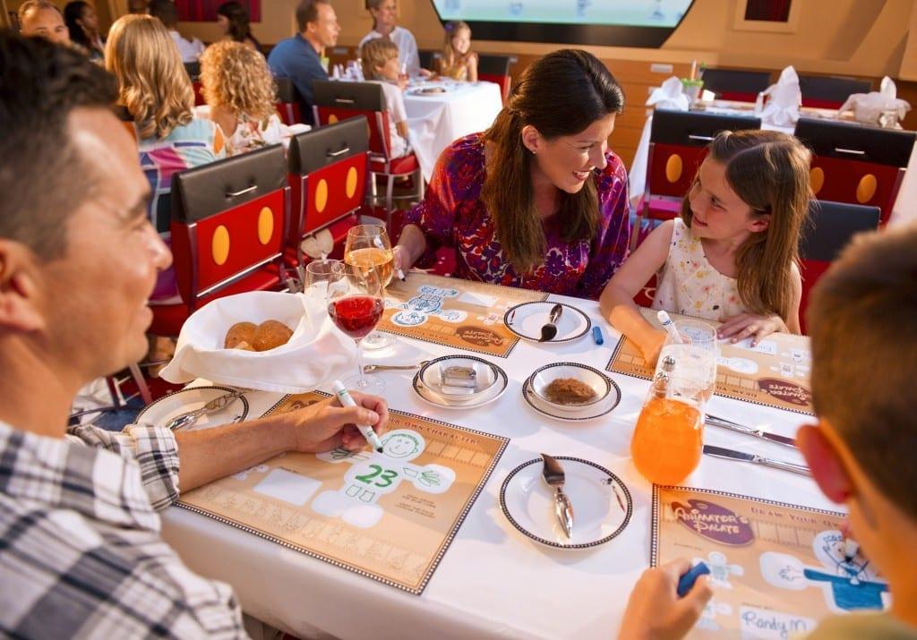 Best Credit Cards for Disney World, family eating, Brads Deals