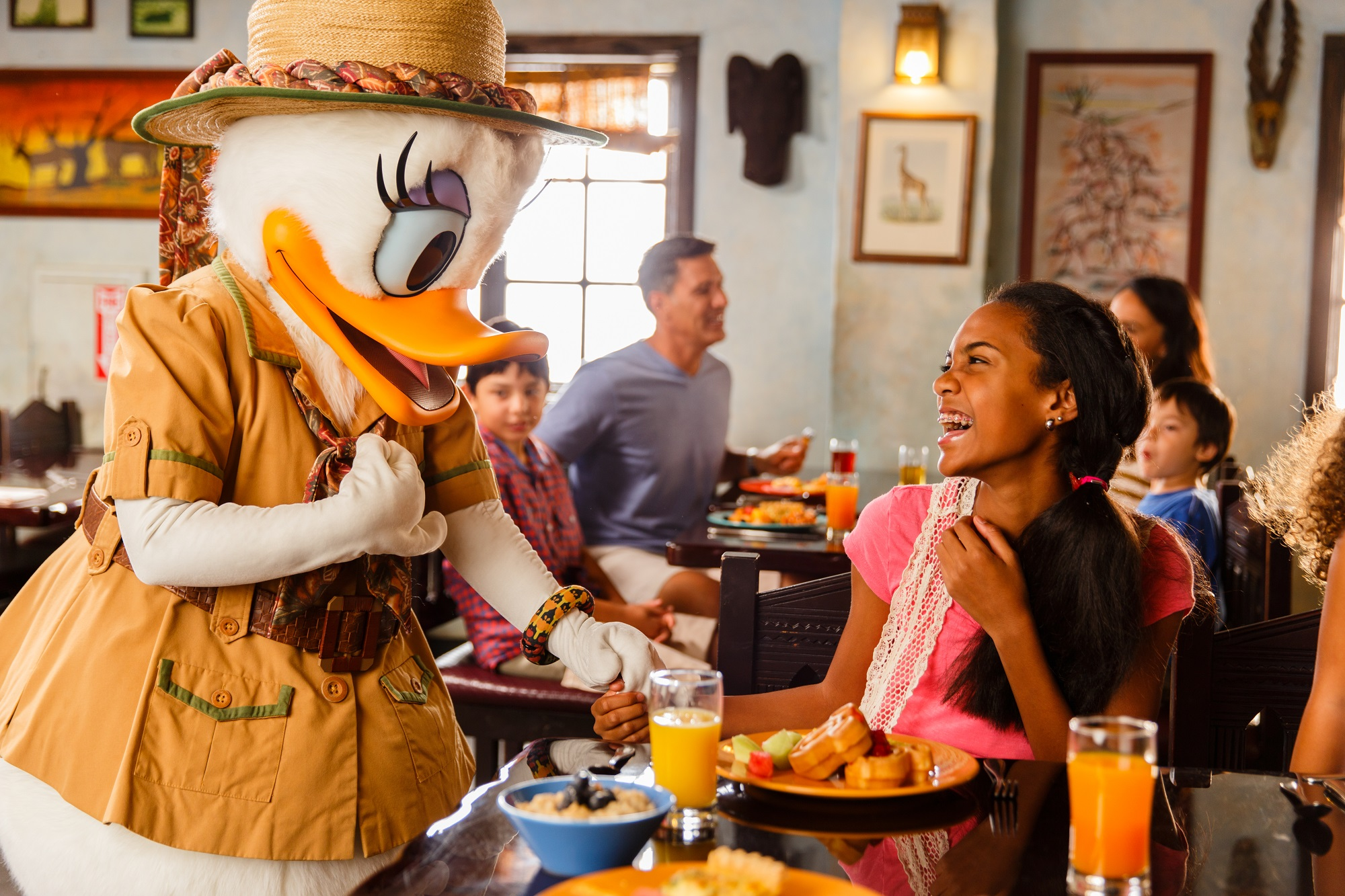 travel deals at Brads Deals, girl eating breakfast with daffy duck