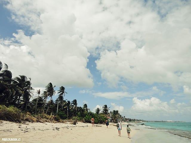 people walking on a Columbian beach