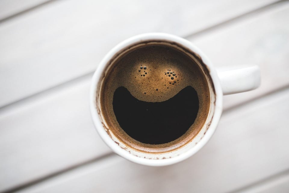 coffee with smiley face in foam