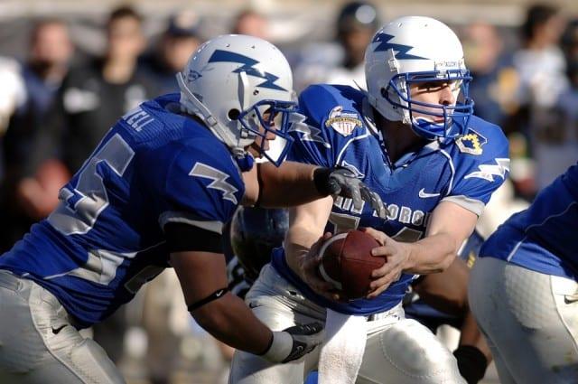 College quarterback handing off