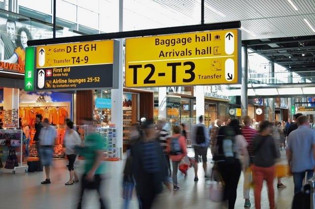 Time lapse of people walking through an airport terminal