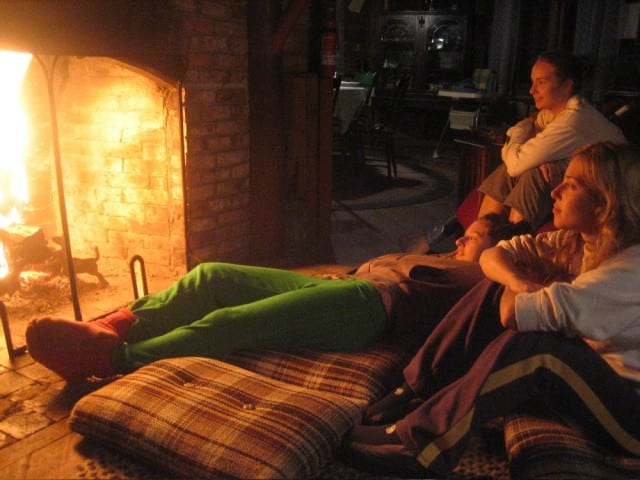 Friends around a fireplace
