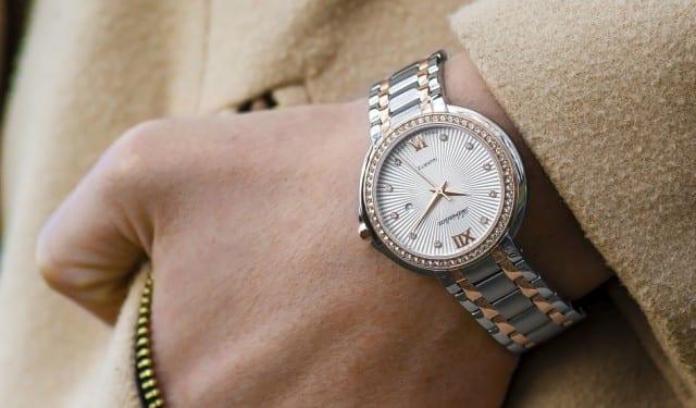 Women wearing a designer watch