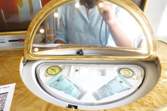 Makeup mirror with lotions
