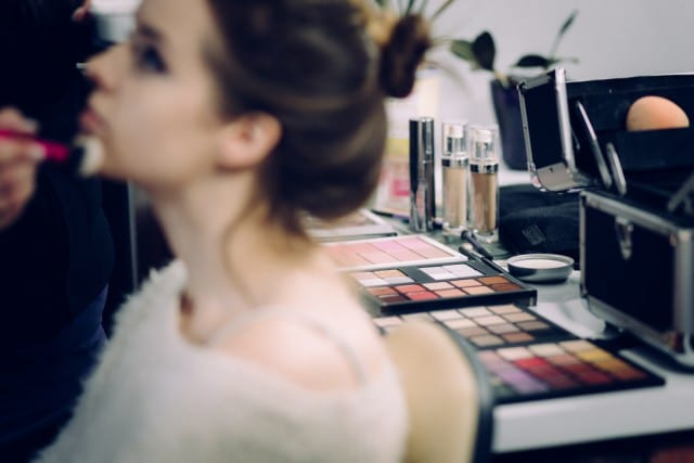 a woman getting makeup on