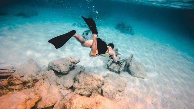 a woman snorkeling