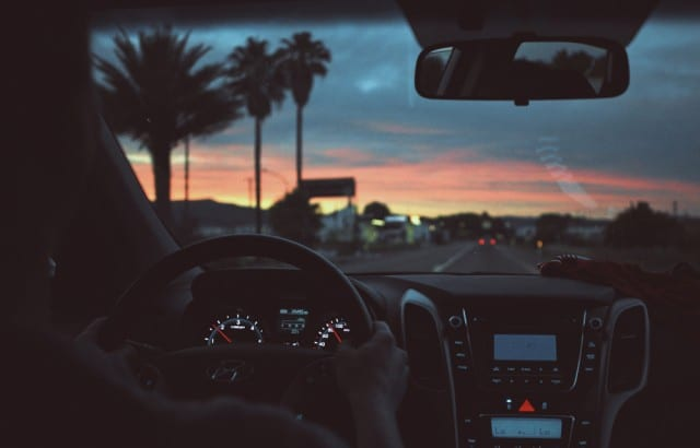 person driving at dusk