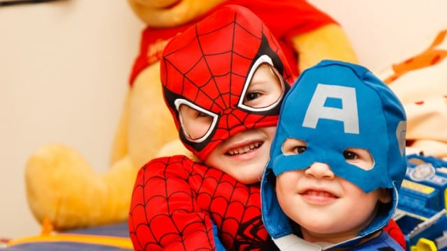 two kids dressed as a super heros