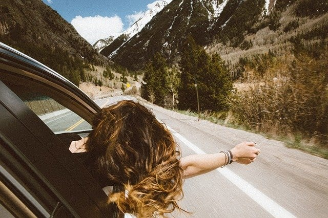woman in car in mountains