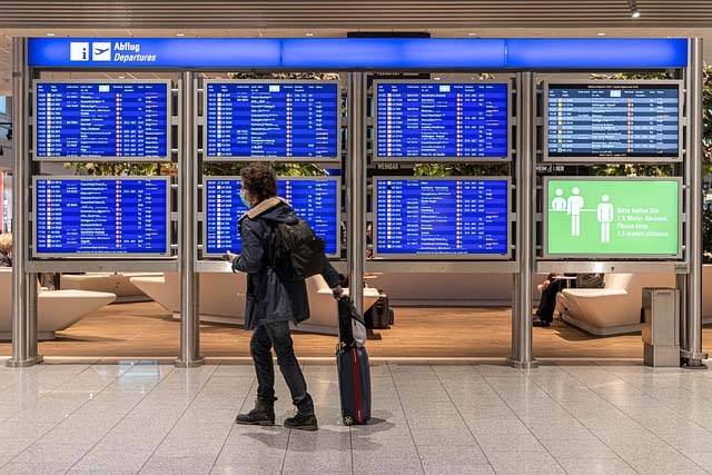 traveler in mask at airport