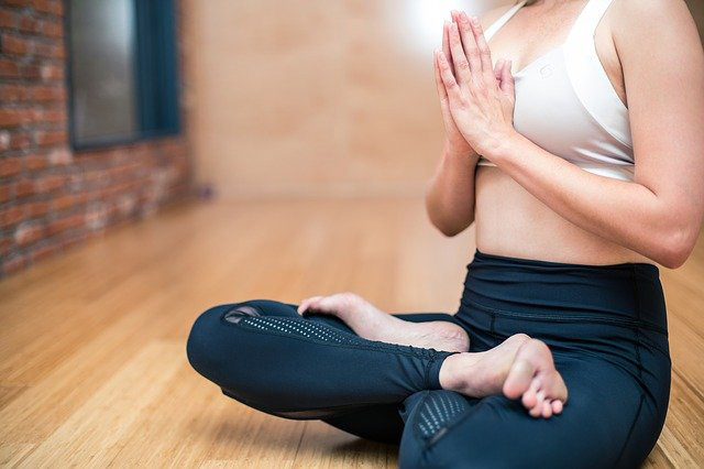 woman yoga seated pose