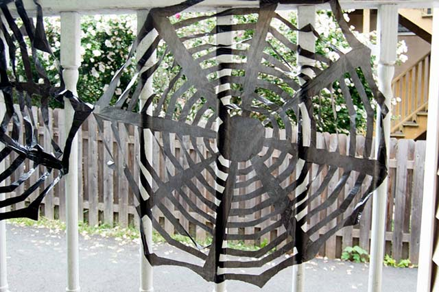 halloween spider web made from trash bags